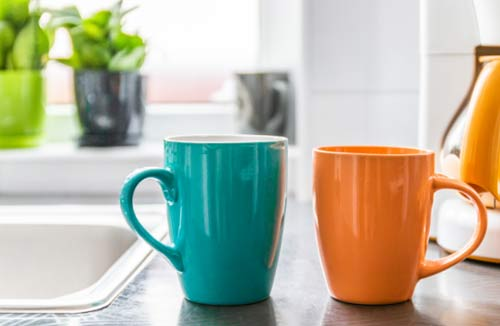 two coffee mugs on a counter